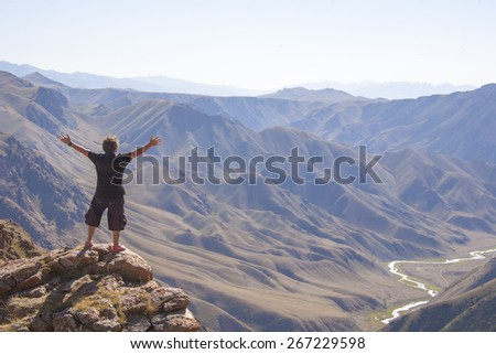 The man in the mountains - stock photo