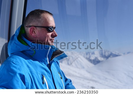 The man in the ski gondola  - stock photo