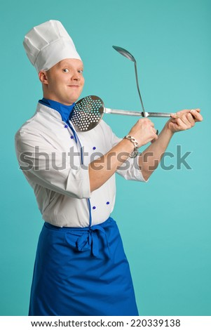 The man in the suit chef holding a frying pan