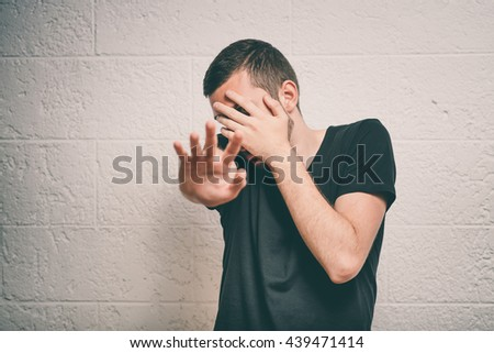 The man is afraid of fear - stock photo