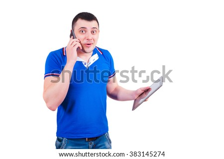 The man is surprised to phone call speaks by phone and holds the tablet in hand. Joyfully surprised guy on a white background. - stock photo