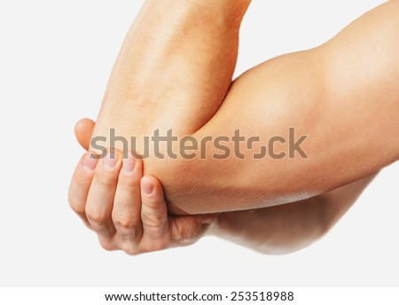 The man is touching the elbow due to acute pain. On a white background - stock photo