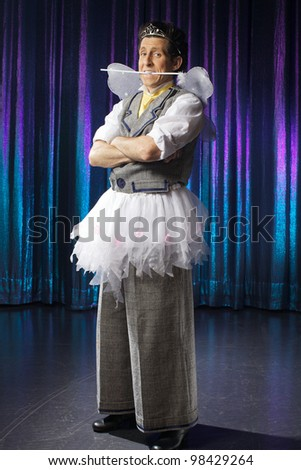 The man is wearing fairy costume - stock photo