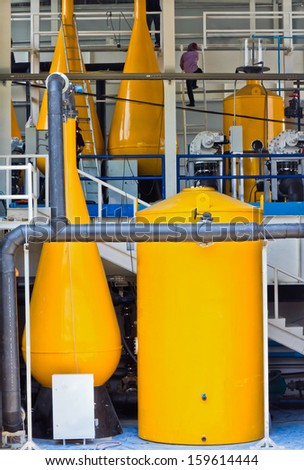 the man is working in the industrial factory - stock photo