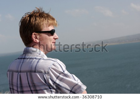 The man looks at Sevan in Armenia - stock photo