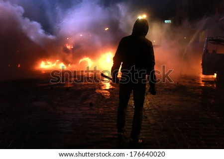The man on the background of burning police buses. Kyiv, Ukraine, January 19, 2014 - stock photo