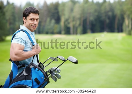 The man on the golf course - stock photo