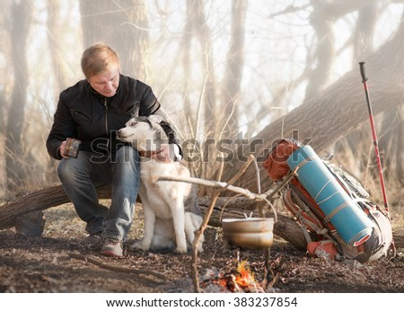 The man on the train with a dog - stock photo