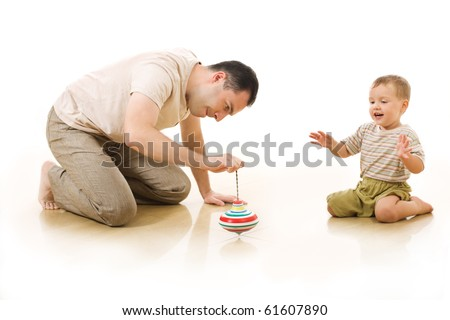 The man plays with his little son - stock photo
