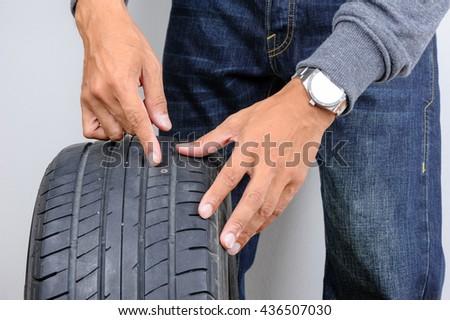 The man repairing flat car tire with repair kit, Tire plug repair kit for tubeless tires. - stock photo