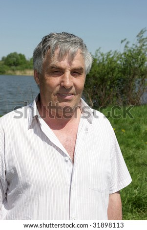 The man resting on a river bank