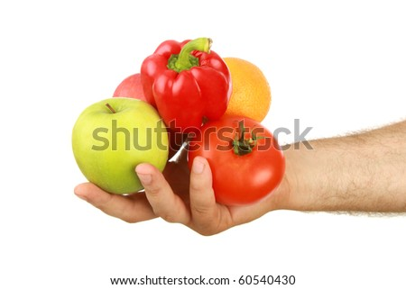The man's hand holds fruit, is isolated on a white background
