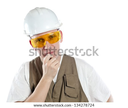 The man, the builder, in goggles and a helmet