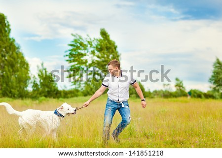 The man trains the dog. Educating dog. Play with a pet. Dog handler - stock photo