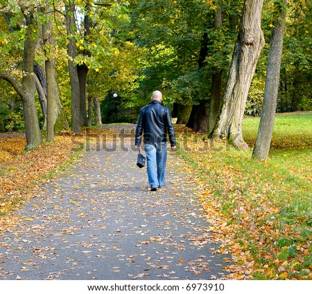 The man walks in park