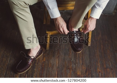 The man wears brown shoes. Close-up.