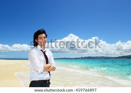 The man who relaxes on the beach.