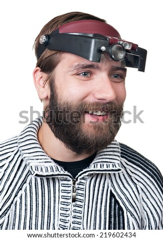 the man with a beard in magnifying points it is isolated on a white background - stock photo