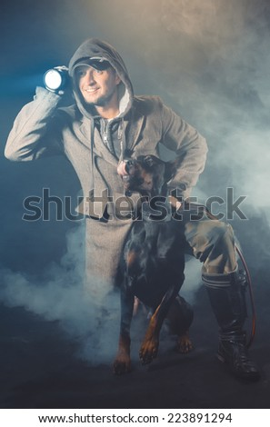 The man with a lantern and a dog