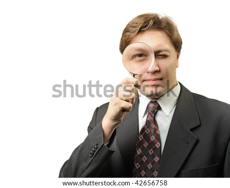 The man with a magnifier. It is isolated on a white background - stock photo
