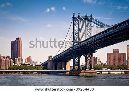The Manhattan Bridge seen from Brooklyn Bridge Park. - stock photo