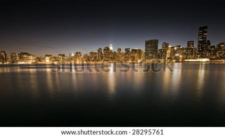 the Manhattan skyline at night - stock photo