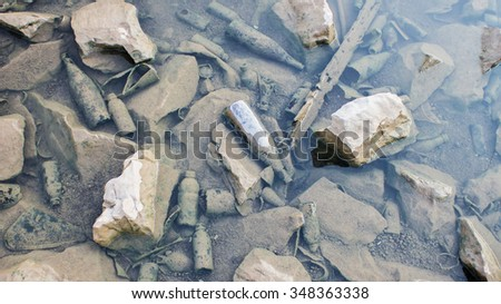 The  many bottle glass garbage under the water - stock photo