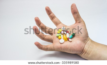 The many pill capsules in on the white background - stock photo