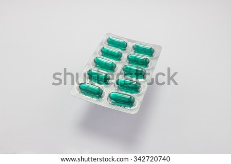 The many pill capsules in the package on white background - stock photo