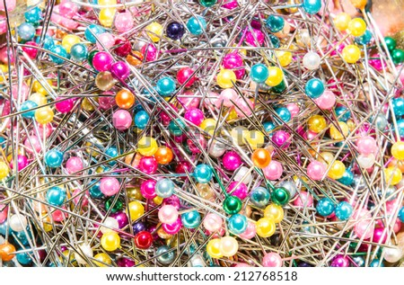 the many sewing push pins together in the sewing tool box - stock photo