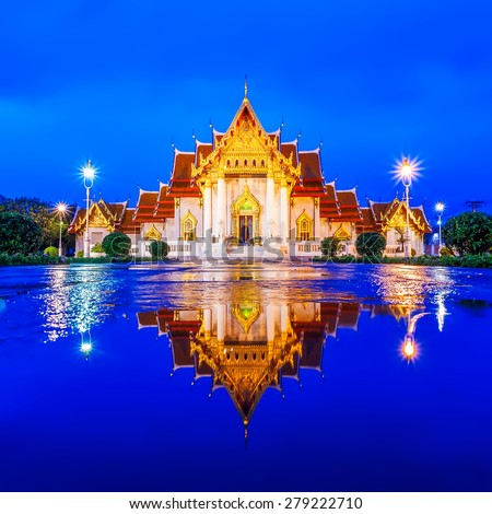 The Marble Temple, Wat Benchamabopit Dusitvanaram in reflection, Bangkok, Thailand - stock photo