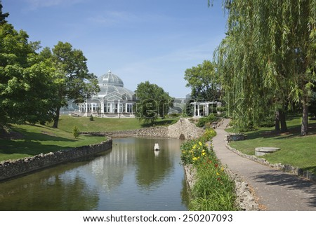 The Marjorie MacNeely Conservatory at Como Park in St. Paul Minnesota on a bright summer afternoon