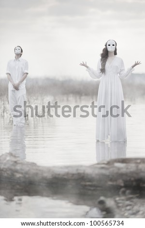 The Masked Players - stock photo