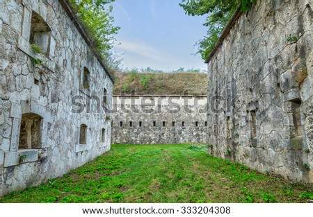 The massive bastions with gun ports and a passage between the inner and outer walls. - stock photo