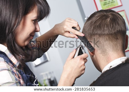 The master the hairdresser does a hairdress in salon
