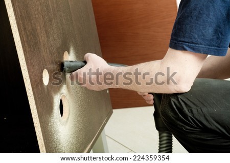 the master working over new kitchen cases - stock photo