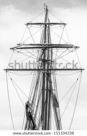 The masts and rigging boat in the port of Reykjavik city, Iceland (black and white) - stock photo