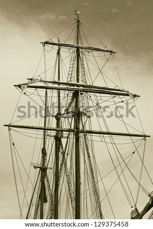 The masts and rigging boat in the port of Reykjavik city, Iceland (stylized retro) - stock photo