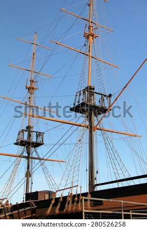 The masts and rigging of the tall ship - stock photo
