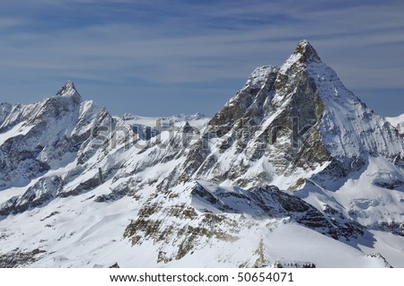 The Matterhorn in the swiss alps with the dent d'herens on the left