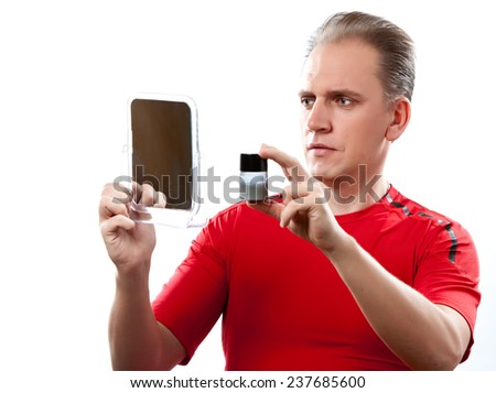 The mature man has reflected on application of a man's cream against wrinkles  - stock photo
