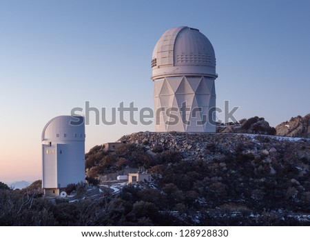 The Mayall Observatory sits atop Kitt Peak at sunset, awaiting darkness.