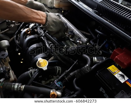 The mechanic is repairing the car.