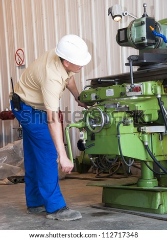 the mechanic serves the lathe - stock photo