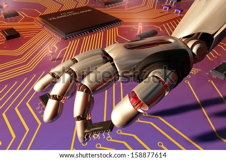 The mechanical arm and a  chips on the board. - stock photo