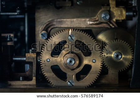 The mechanism of a old and vinage machine.