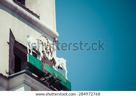 The mechanized goats, which butt heads daily at noon. - stock photo