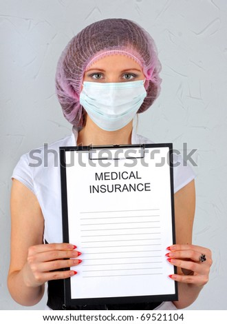 The medical insurance. The doctor with a tablet - stock photo