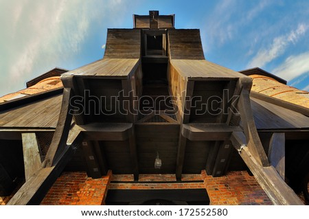 The medieval Crane in Gdansk, portion of the building, At present, the crane was built in the years 1442-1444, the view from the bottom, Poland, Gdansk - stock photo
