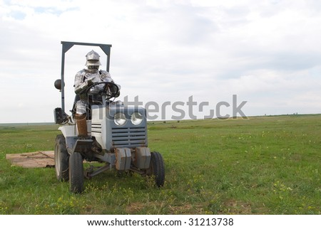 The medieval knight on a tractor in field